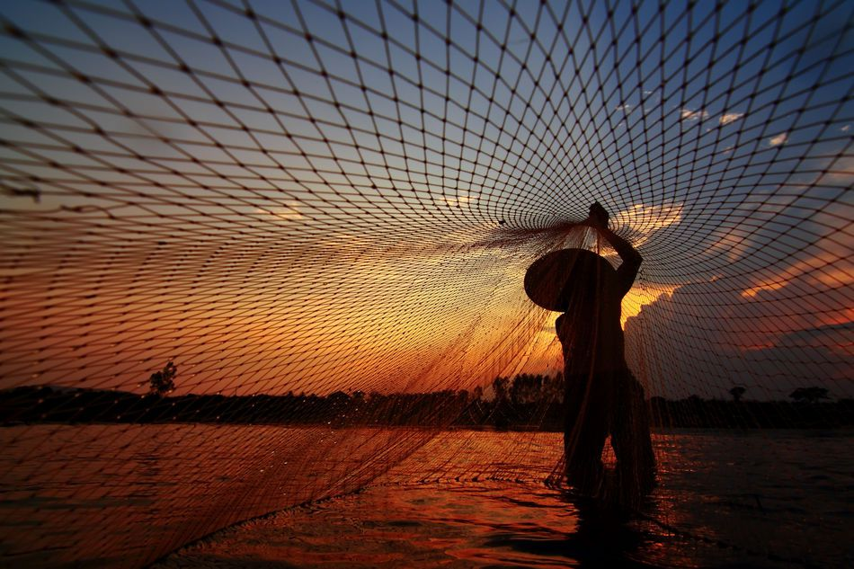 Fisherman in Mekong River