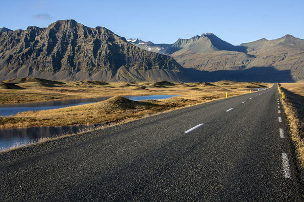 Road stretching into the mountains in Iceland