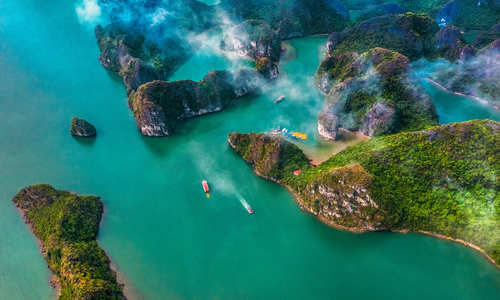 Aerial view of Sang cave and Kayaking area rock island, Halong Bay