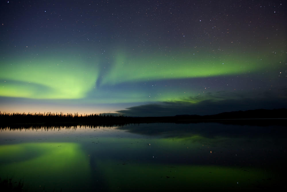 Northern Lights over a lake in Alaska