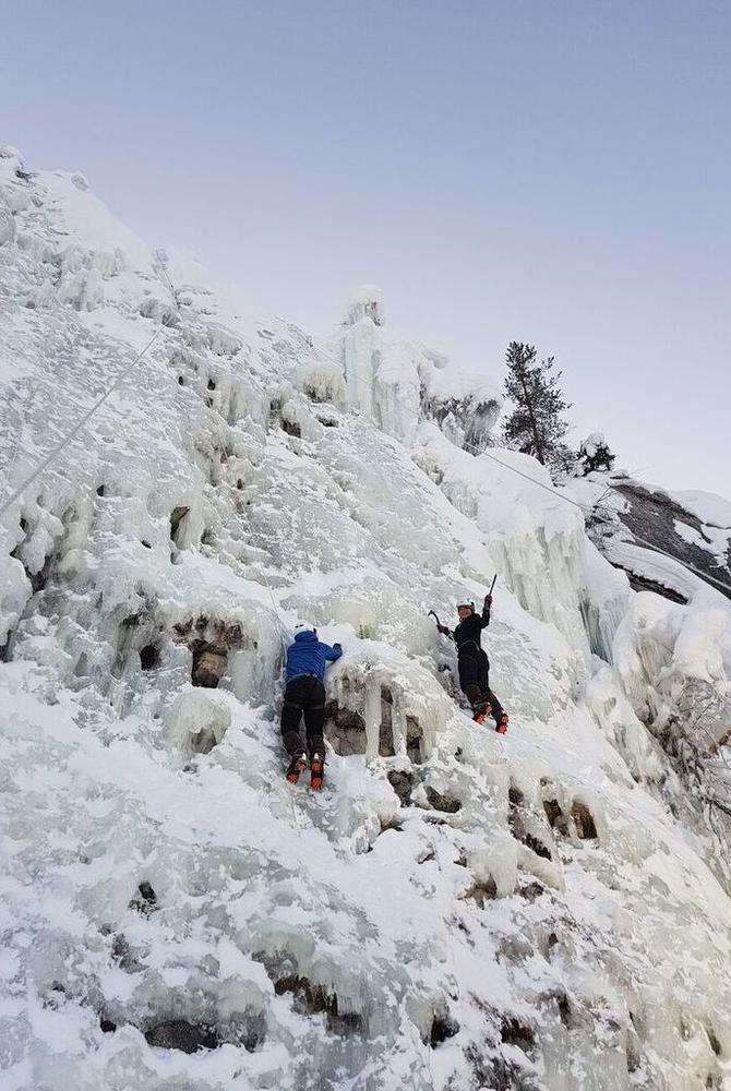 Angela ice climbing in Pyha-Luosto National Park