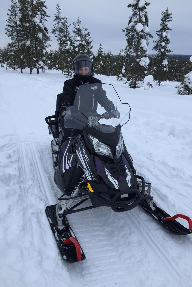 Angela snowmobiling in Finnish Lapland