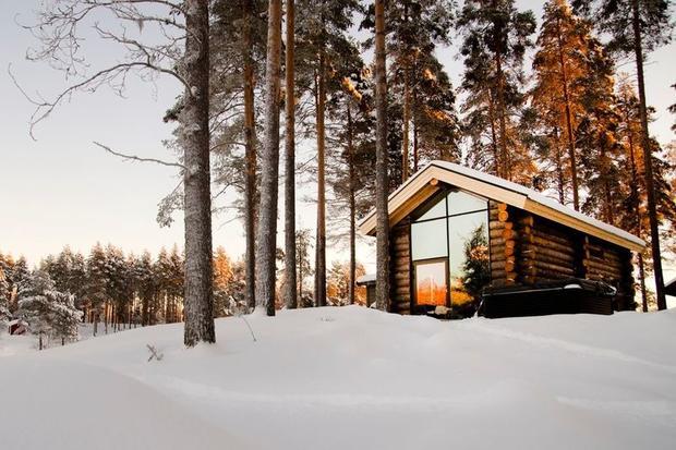 Arctic Retreat cabin in snowy forest in winter, Lulea, Swedish Lapland