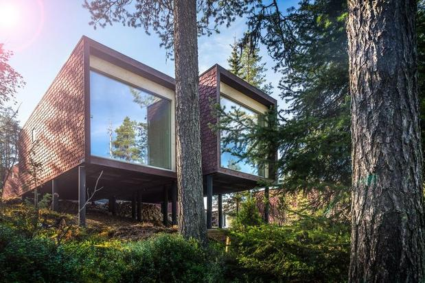 Glass-fronted suite at Arctic TreeHouse Hotel in Finnish Lapland