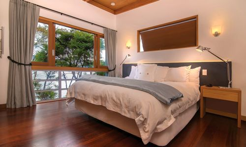 Bay of Many Coves Kereru suite bedroom, New Zealand