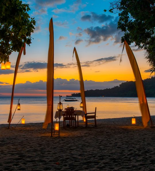 Beach dining at dusk, Amanwana