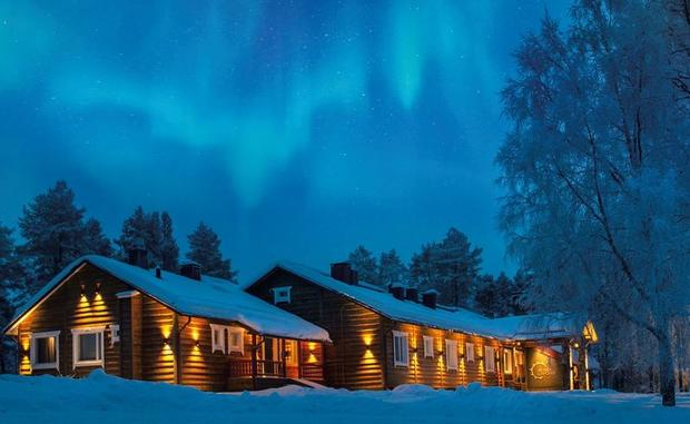 Northern Lights over Beana Laponia cabins in Finland