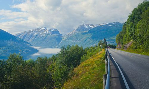 Beautiful landscape with norwegian road, fjord and mountains