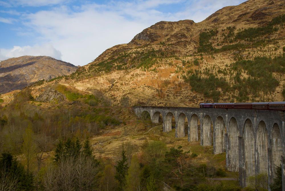 Belmond's Royal Scotsman on a bridge in the Scottish highlands