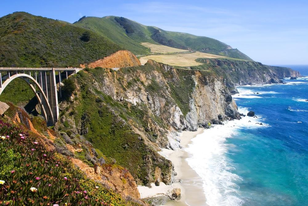 Road winding along coastal cliffs on Pacific Coast Highway, California
