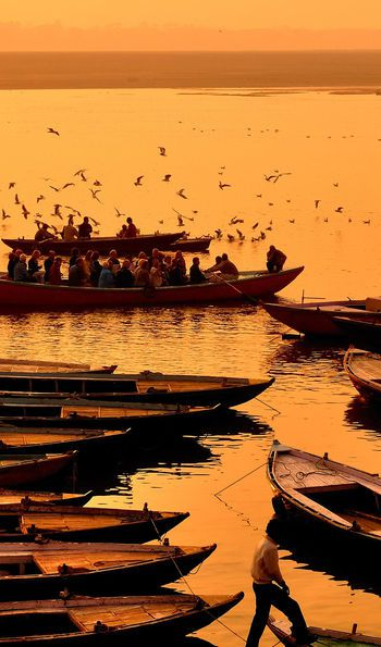 Boats on the Ganges at dawn for morning prayers
