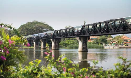 Eastern & Oriental Express passing over the Bridge over the River Kwai