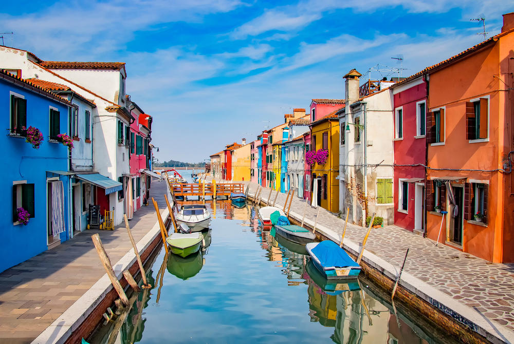 Colourful boats and buildings in Burano, Venice