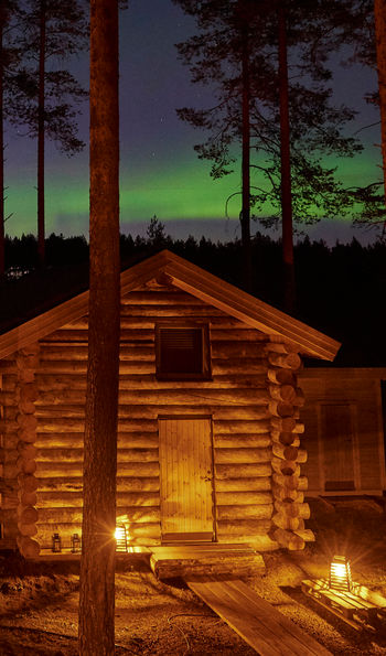 Northern Lights over the cabin, Arctic Retreat