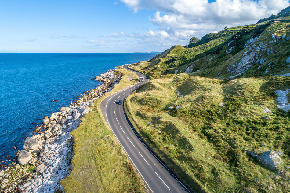 Cars on the Giant's Causeway Coastal Road in Northern Ireland