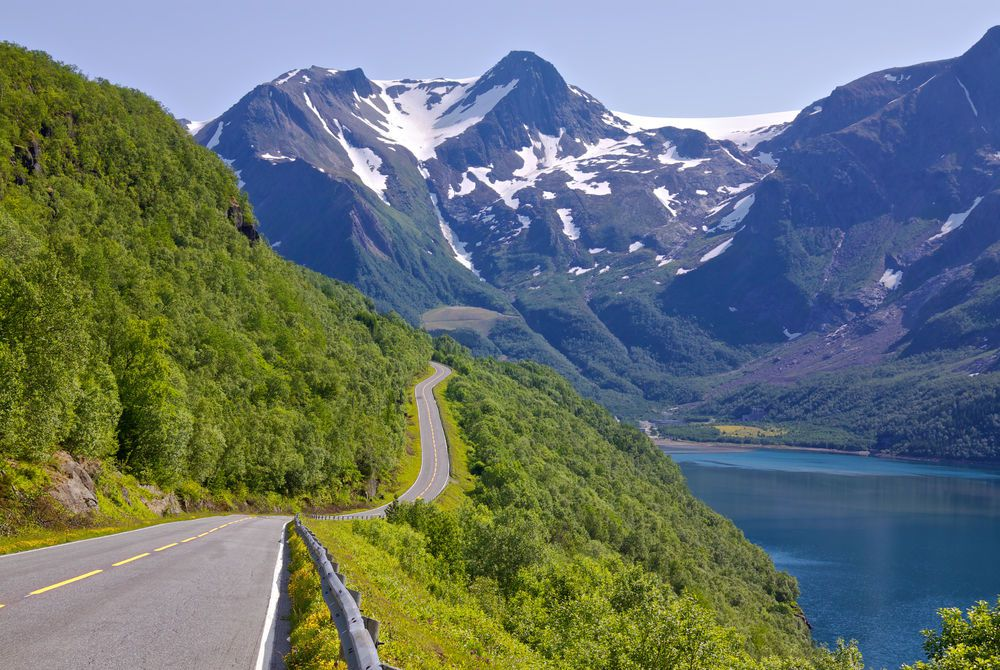 Coastal road to Bodo with Saltfjellet-Svartisen National Park in the background, Norway