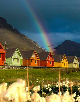Colourful Housses with Rainbow in background, Hurtigruten Svalbard, Svalbard