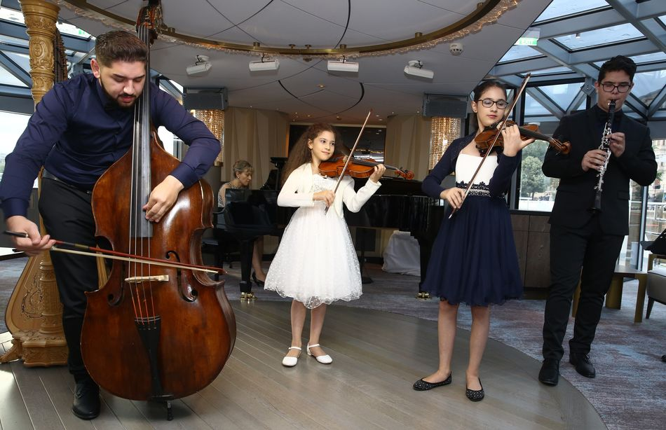 Young Virtuosos artists performing on board Crystal Ravel