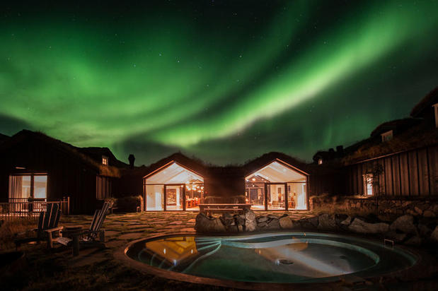 Northern Lights in front of the Deplar Farm hotel in North Iceland