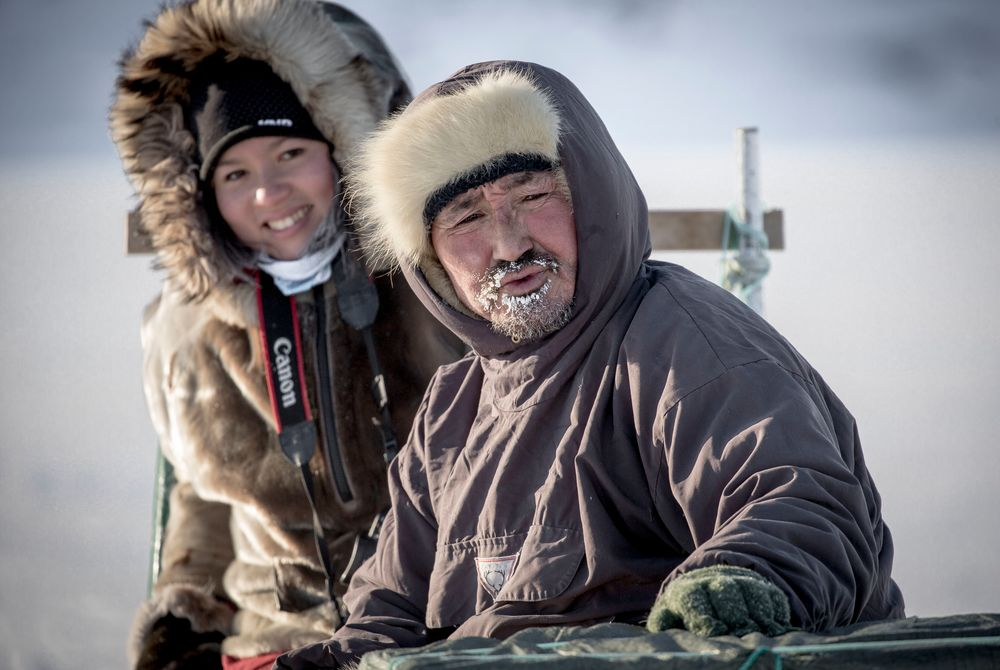 Dog Musher and Guest (Photo by Mads Pihl - Visit Greenland)