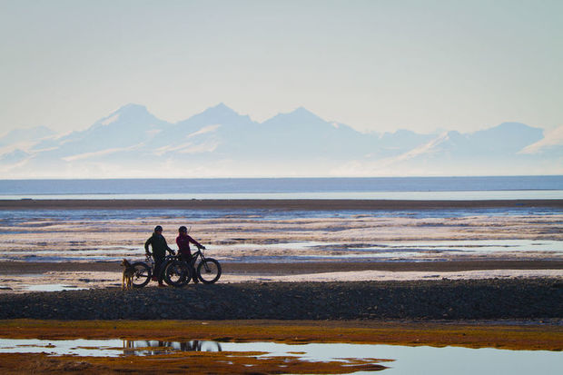 Couple on electric fatbikes on Svalbard