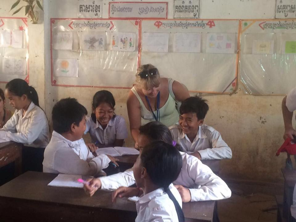Emma Sanger-Horwell with a local school in Cambodia