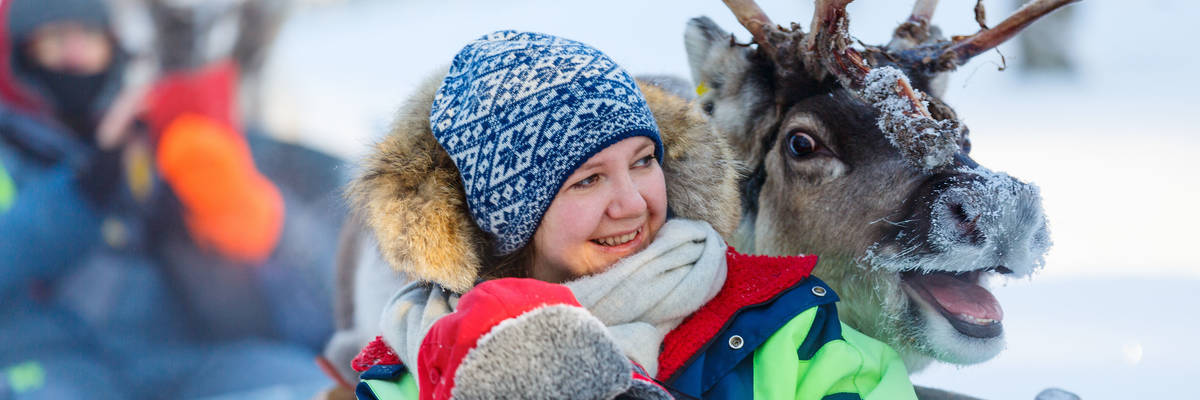 Family reindeer fun in Finland