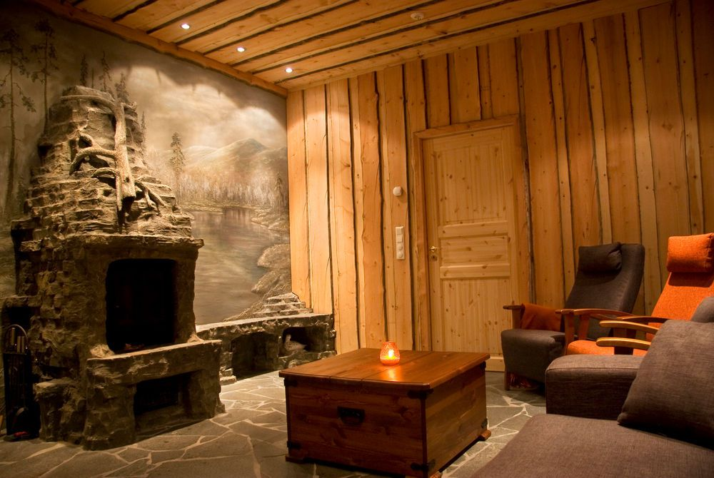 fireplace room arctic snowhotel and glass igloos finnish lapland