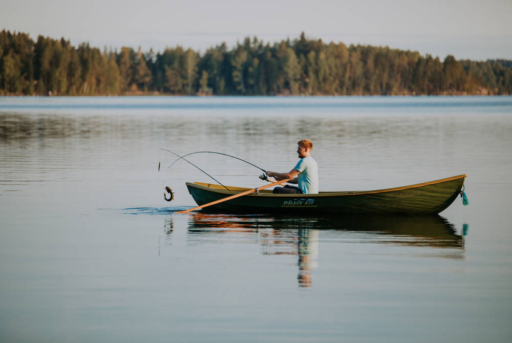 Fishing on the lake, Lehmonkarki, Lahti, Finland (Credit: Julia Kivela)