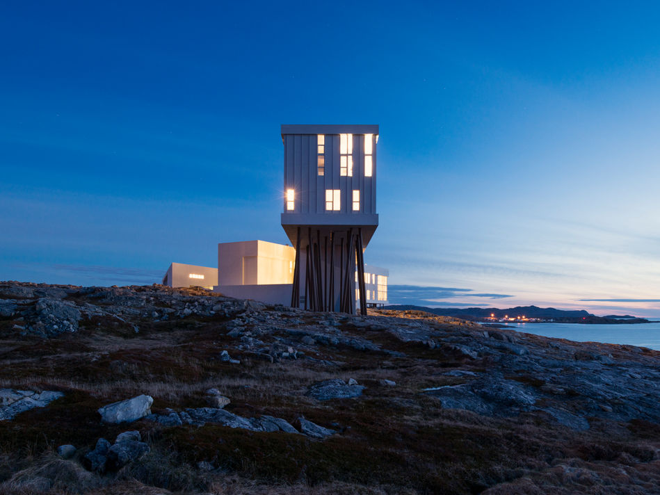 "Exterior of Fogo Island Inn at dusk""><br></p><p> </p><p>Venture from your room, and you'll find a locally-curated art gallery (<a href="