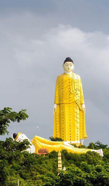 Giant standing Buddha at the Maha Bodhi Tahtaung in Burma