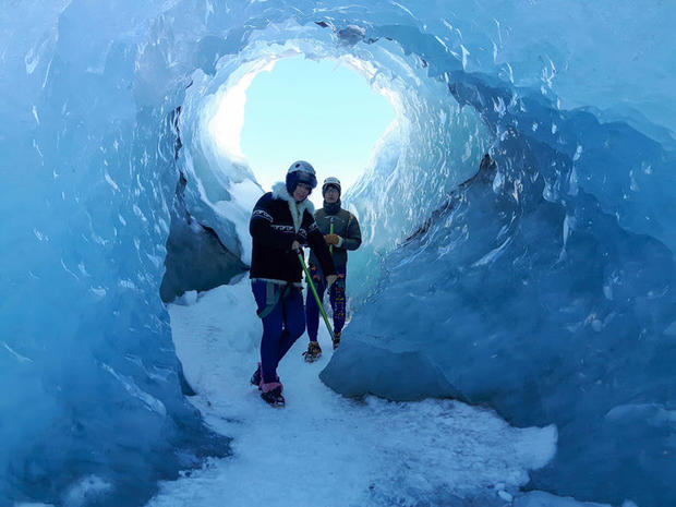 Couple hiking into a glacier