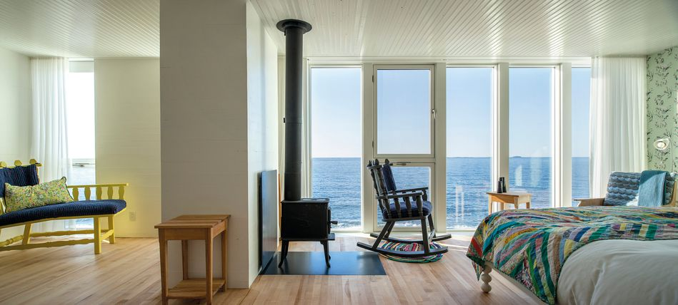 "Fogo Island Inn guest suite""><br></p><p>What makes this hotel one of the amazing few to be featured by the BBC is not just its incredible location overlooking the sea, or its laudable local support, but its top of the line guest facilities. Each of the 29 guest rooms have floor-to-ceiling windows, allowing every visitor their own world-class ocean view. Locally-sourced textiles and furniture decorate each room, and many have individual wood-burning stoves.</p><p style="