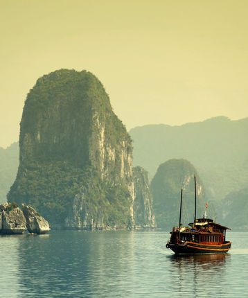 Halong Bay and traditional junk ship in Vietnam