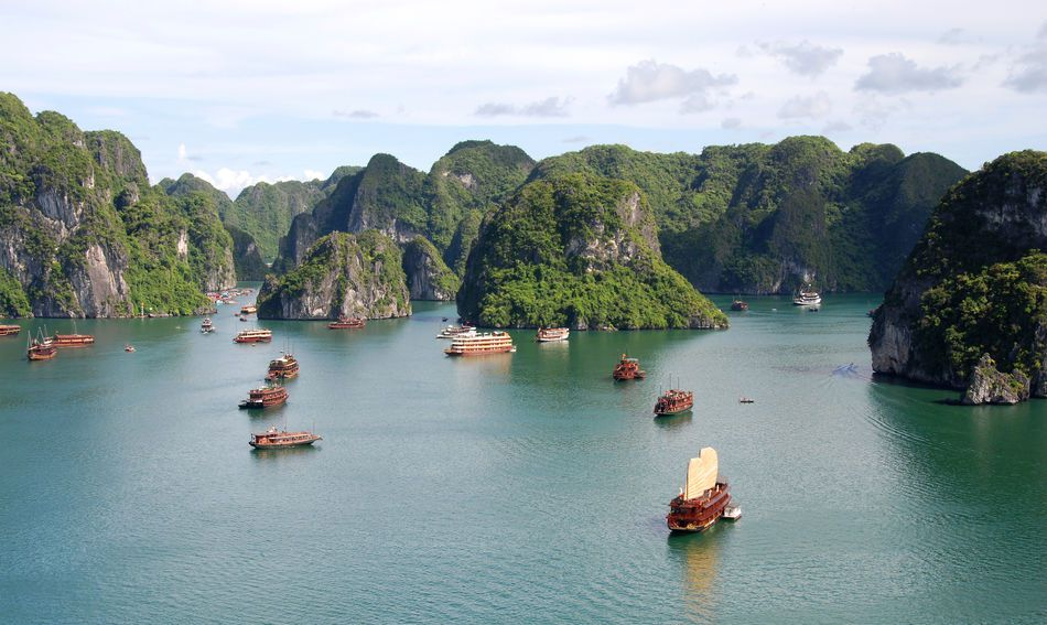 Traditional junk ships cruising Halong Bay