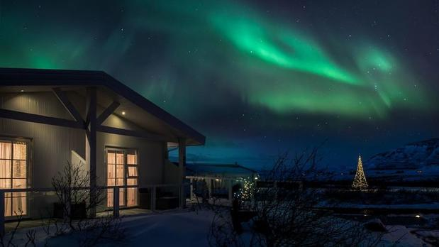 Northern Lights outside rooms at Hotel Grimsborgir in Iceland