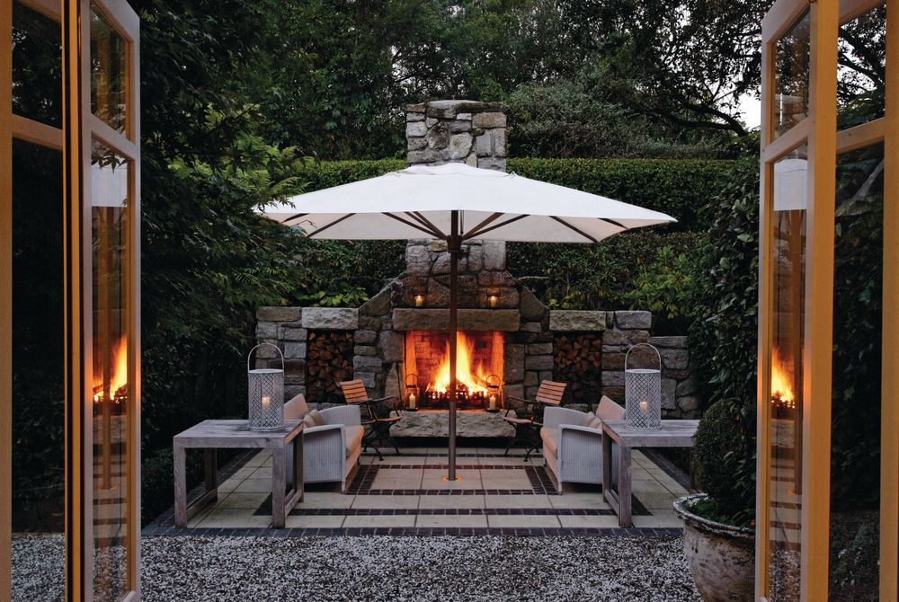 Huka Lodge outdoor fireplace at the owner's cottage, New Zealand
