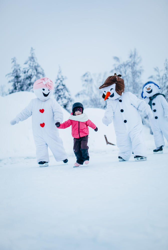 Ice skating with snowmen at Santa's Village, Rovaniemi, Finnish Lapland (Credit: Visit Rovaniemi)