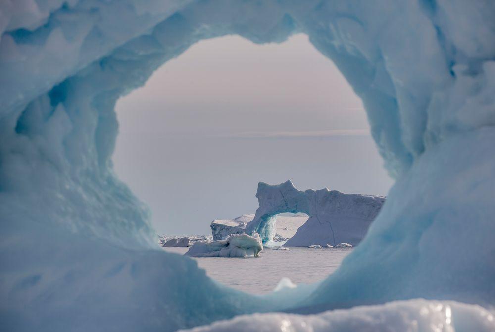 Iceberg & Iceberg Arch (Photo by Mads Pihl - Visit Greenland)