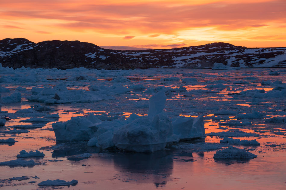 Icebergs under the Midnight Sun in Ilulissat, Greenland