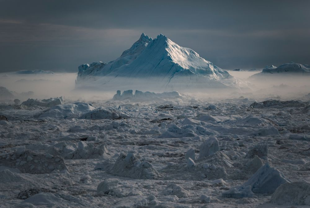 Iceberg in mist at sunset, Ilulissat Ice Fjord Photo by Mads Pihl - Visit Greenland