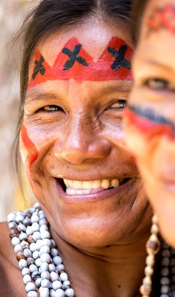 Two Amazonian tribes people share a laugh