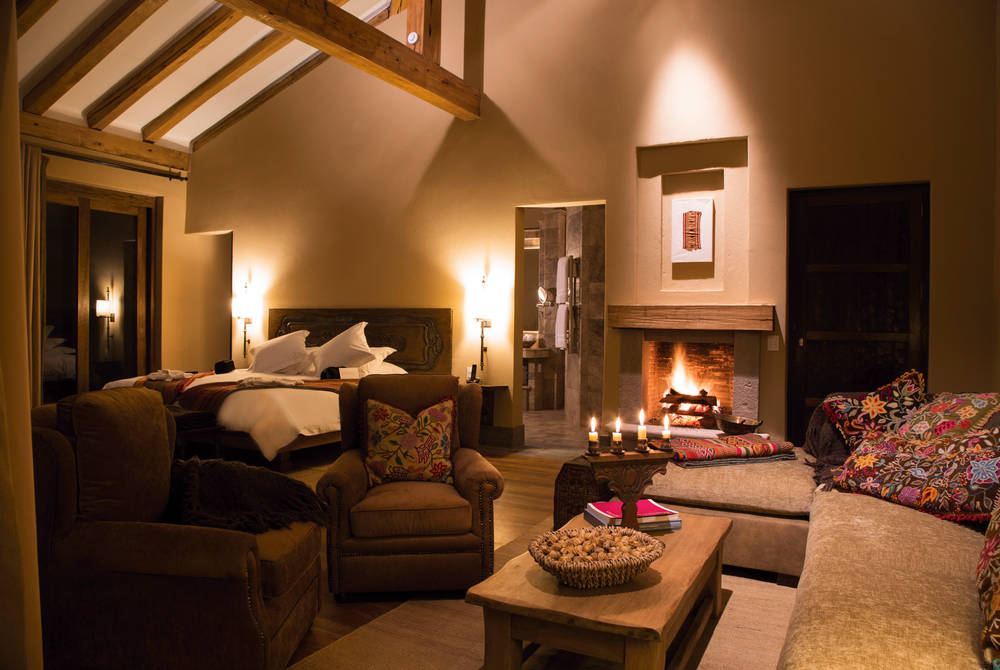 Bedroom with fireplace, Inkaterra Hacienda Urubamba