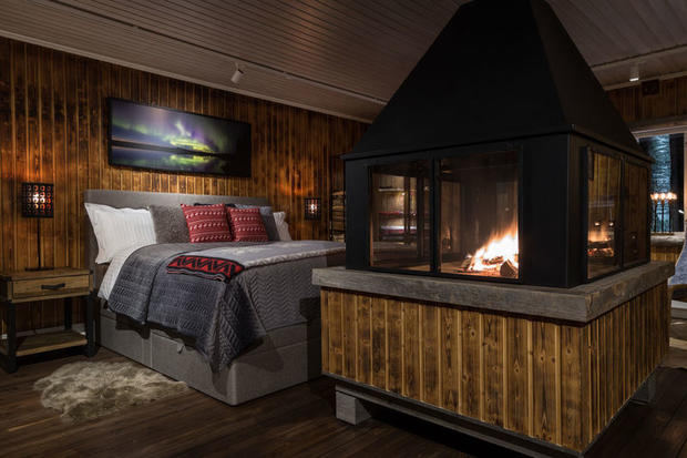Roaring fire and bed at Loggers Lodge in Sweden