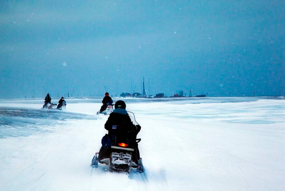 Snowmobile ride to Isfjord Radio