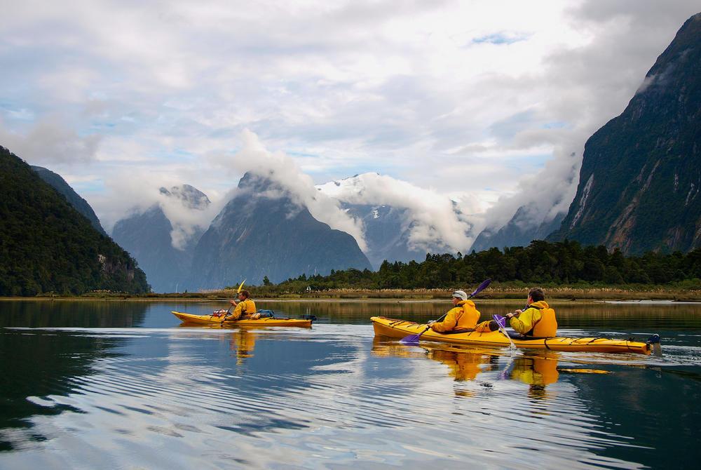 People Kayaking in Milford Sound