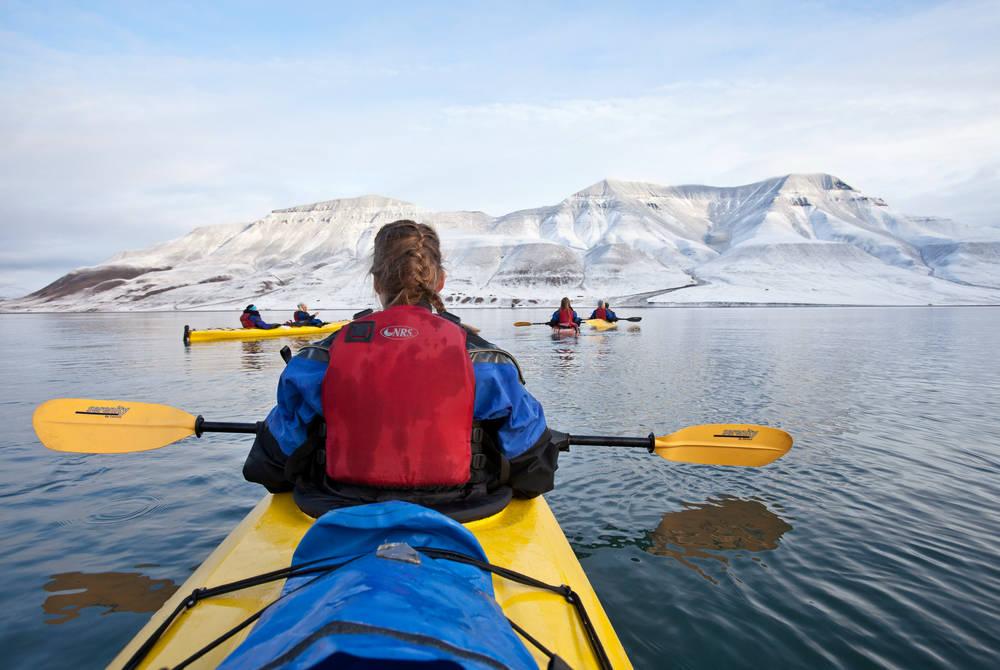 Kayaking on Adventfjord, Credit: Tommy Simonsen, Hurtigruten