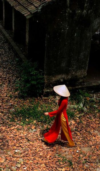 Lady in traditional Vietnamese dress in Vietnam