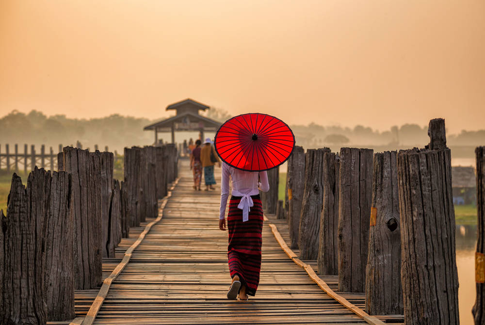Lady walking over U Bein Bridge