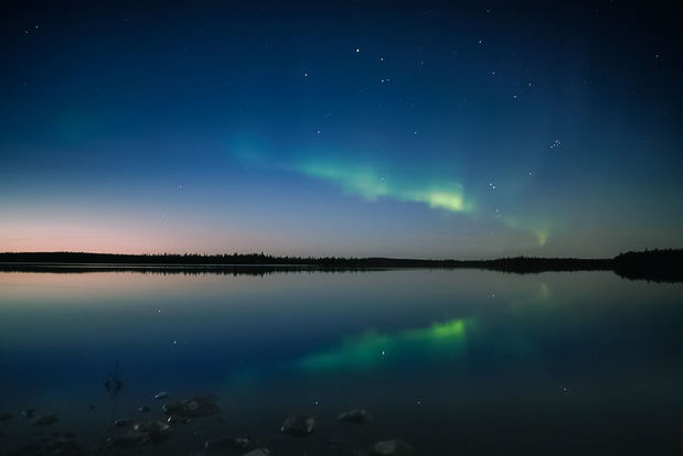 The Northern Lights over a lake near Levi, Finnish Lapland